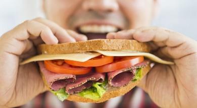mixed-race-man-eating-sandwich-1